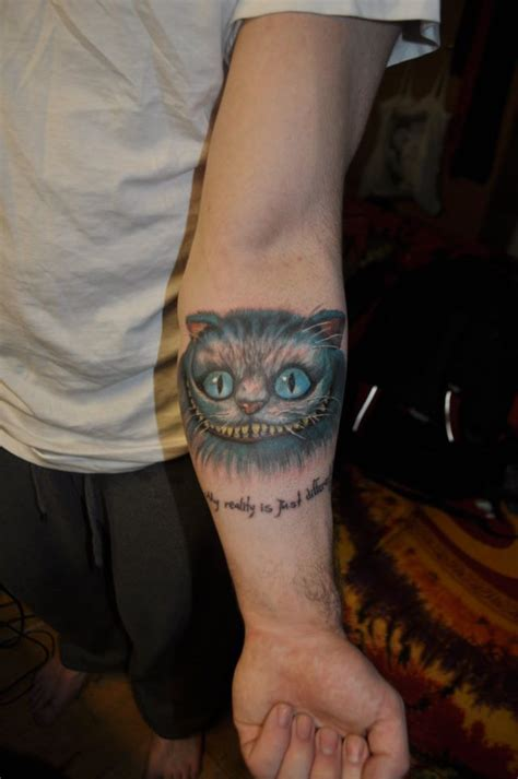 My first tattoo, the Cheshire Cat